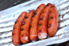 Barbeque sausages on a grill Stock Photo