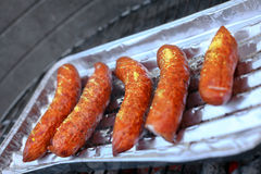 Barbeque sausages on a grill Stock Photos