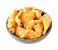 Barbeque seasoned pork rinds in an old bowl Stock Images