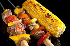 Barbeque sticks. With meat, vegetables and corn stock photography