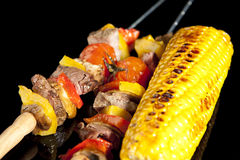 Barbeque sticks. With meat, vegetables and corn Stock Images