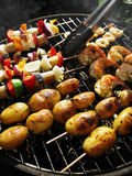 Barbeque. Vegetarian barbeque, with rosemary potatoe sticks, vegetable sticks and prawn sticks Royalty Free Stock Photography