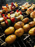 Barbeque. Vegetarian barbeque, with rosemary potatoe sticks, vegetable sticks and prawn sticks Stock Images