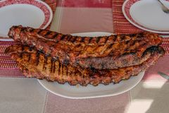 Barbequed Ribs. Barbequed pork ribs on barbeque royalty free stock image