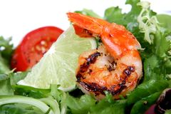 Barbequed prawn salad with shrimp lettuce and green lime Royalty Free Stock Photo