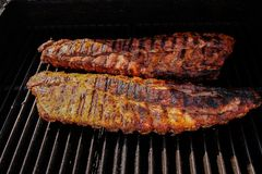 Barbequed Ribs. Barbequed pork ribs on barbeque stock photos