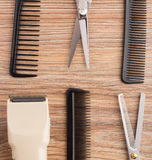 Barber accessories on wooden table Royalty Free Stock Image