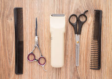 Barber accessories on wooden table Stock Image
