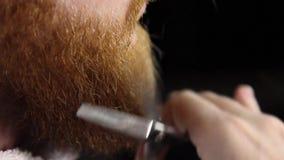 Barber' barba do corte da mão de s vídeos de arquivo