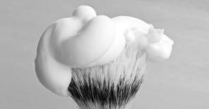 Barber brush mono. Monochrome photo of barber brush with cream Royalty Free Stock Photography