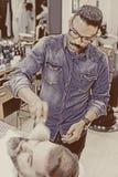 Barber brushing beard Royalty Free Stock Image