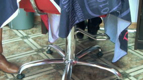 Barber chair customer Stock Photos