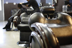 Barber chairs. In a barber shop Royalty Free Stock Image
