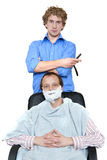 Barber and Client. Barber, holding a razor posing whilst shaving a client Royalty Free Stock Image