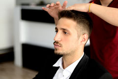 Barber and client Stock Photos