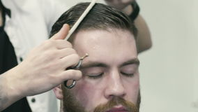 Barber combing hair stock video footage