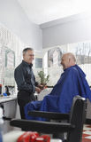 Barber And Customer In Hair-Salon Stock Fotografie