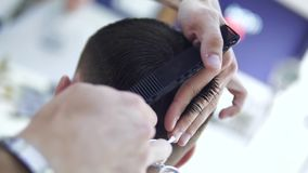 Barber cuts the hair of the client with scissors. Cuts the hair of the client with scissors stock footage