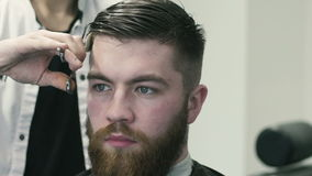 Barber cutting hair stock video footage