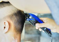 A barber is cutting Hair for Children Royalty Free Stock Images