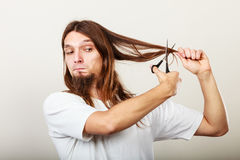 Barber cutting hair Stock Images