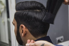 Barber cutting hair Stock Image
