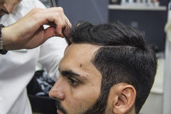 Barber cutting hair stock photo