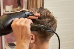 Barber Drying Hair Close Up. Royalty Free Stock Photography