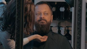 Barber finishing beard trimming stock footage