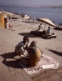 Barber at the ghats of the Ganges in Banaras stock images