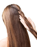 Barber girl braids  the long hair in  braid isolated. Royalty Free Stock Images