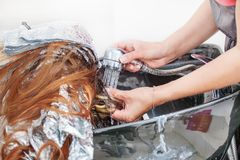 Barber girl washing her hair a client Stock Photo