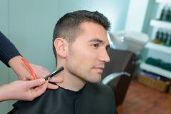 Barber giving man trim royalty free stock photos