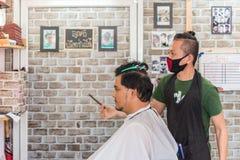 Barber haircut a customer at barbershop Royalty Free Stock Photo