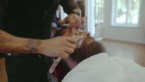 Beard man visiting hairstylist in barber shop stock video footage