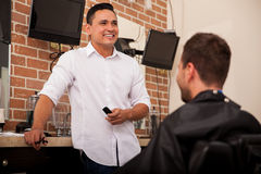 Barber having fun at work Stock Image