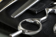 Barber instrument set lying down on leather case Royalty Free Stock Photo