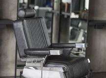 Barber leather seat Royalty Free Stock Photo