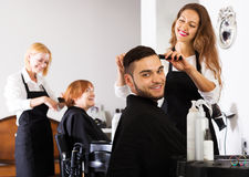 Barber makes the cut for man Royalty Free Stock Photography
