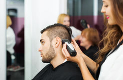 Barber makes the cut for man Royalty Free Stock Photos