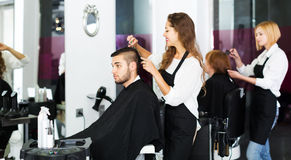 Barber makes the cut for man Stock Image
