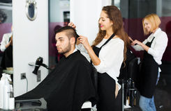Barber makes the cut for man Stock Photography