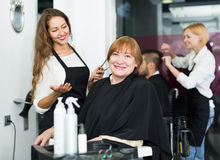 Barber makes the cut for  woman Stock Photo