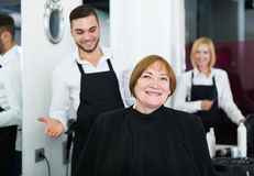 Barber makes the cut for  woman Royalty Free Stock Image