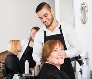 Barber makes the cut for  woman Royalty Free Stock Images