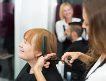 Barber makes the cut for  woman Stock Photos