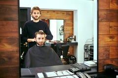 Barber makes men haircut at the beauty salon Stock Image