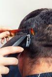 Barber making haircut Stock Image