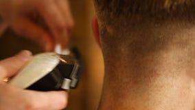 Barber making haircut of man in barbershop stock video