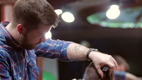 Barber making haircut to hipster stock video